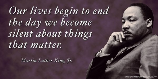 Dr. Martin Luther King Jr. looking pensive with hand to face, white text on purple background: our lives begin to end the day we become silent about things that matter. Martin Luther King, Jr.