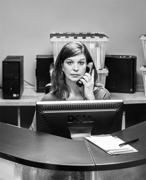 Woman on phone in front of a computer