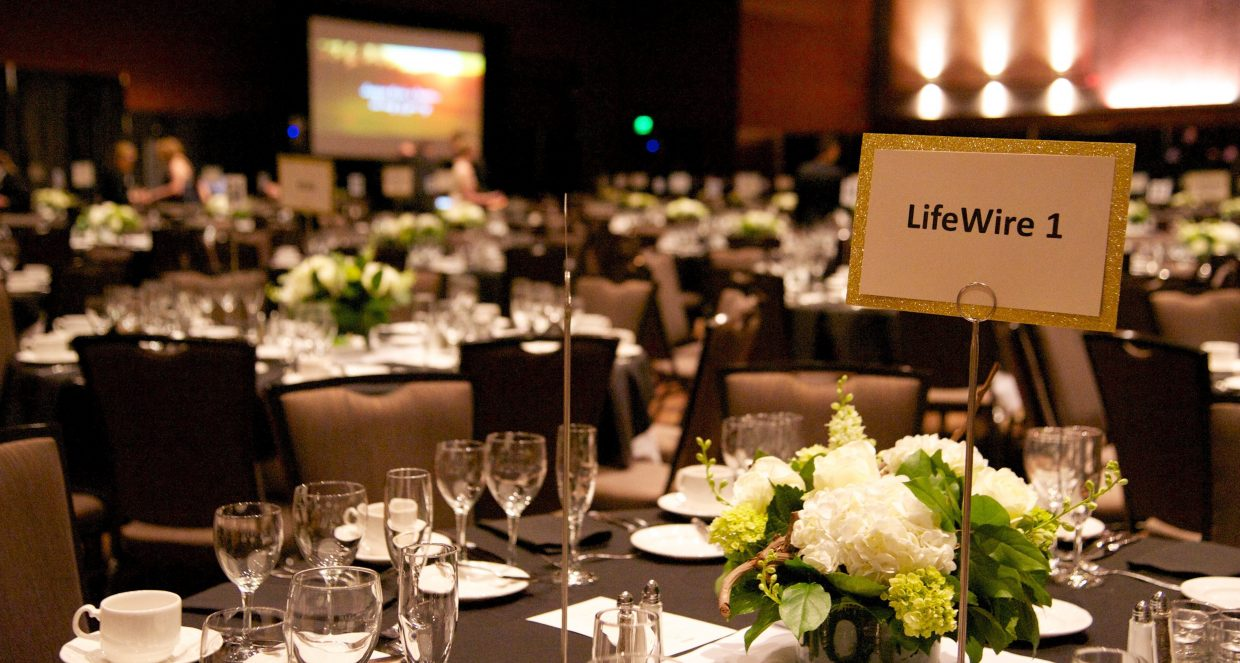 Elegantly set banquet table with LifeWire sign