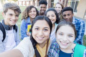 Group of teen smiling at camera