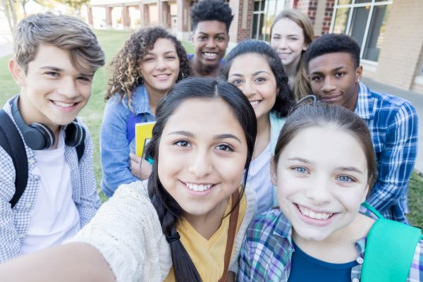 Group of teen smiling at camera